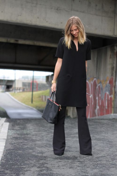 Black tunic dress over slim black boot cut pants