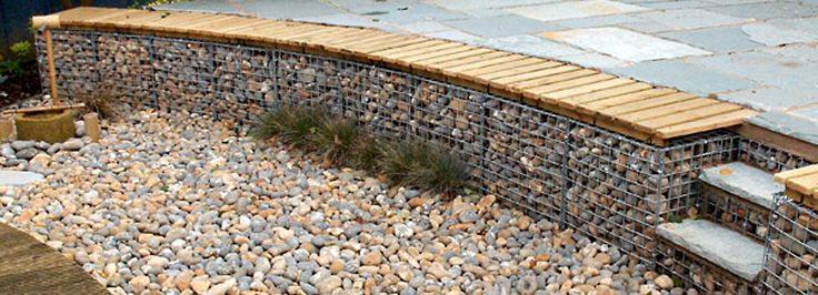Gabion Baskets (this would be very cool for the edge of our back patio~to build in to the base of the little hill!)