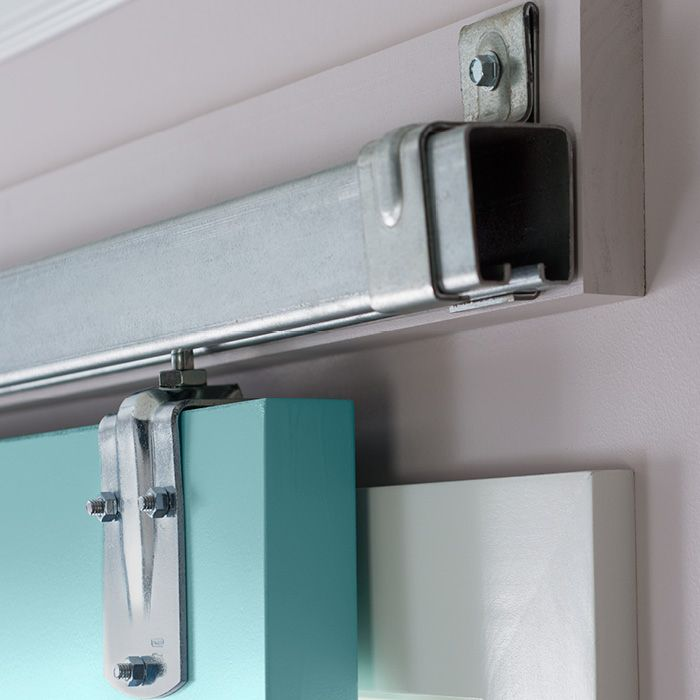 sliding door hardware on a ledger board instead of fastening the barn door rail to