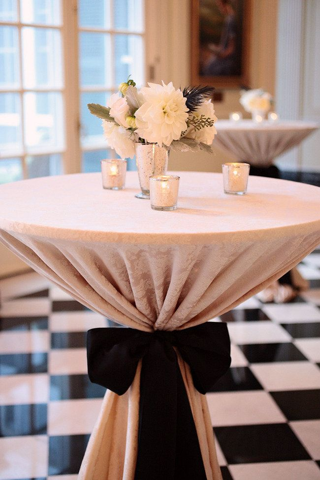 Tall cocktail tables with linens and tied with a bow (white linen & champagne or pink bow?)