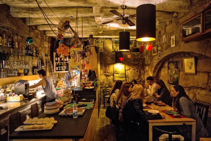 36 Hours in Porto, Portugal - via The New York Times 28.01.2016 | From its stunning Beaux-Arts station to its cool bars serving Porto's signature drink, this charming city combines the best of old and new. Photo: Cozy Trasca offers petiscos (the Portuguese version of tapas).