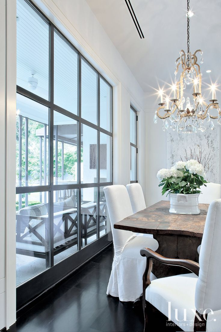 #LGLimitlessDesign & #Contest The garage-door look might be a bit over-the-top for me, but I LOVE the dark trim around the panes and all of the lovely light and views! Modern Casual Dining Area