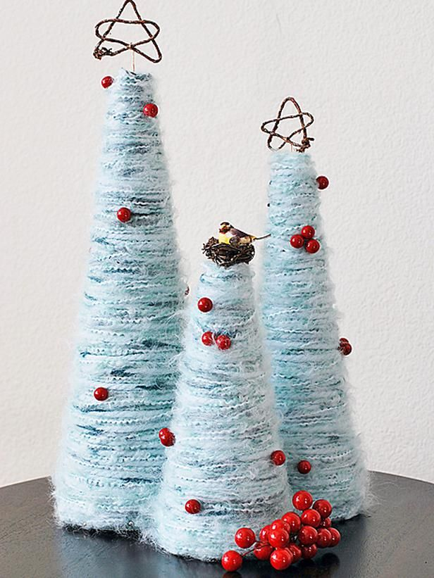 How to Make Yarn Christmas Trees>>  http://www.hgtv.com/handmade/how-to-make-yarn-christmas-trees/index.html?soc=pinterest