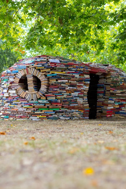 House of Books.! ...guess this is one way to use up books that are no longer needed or replaced by ebooks. What a creative idea. Its a real artistic work. Awesome.!