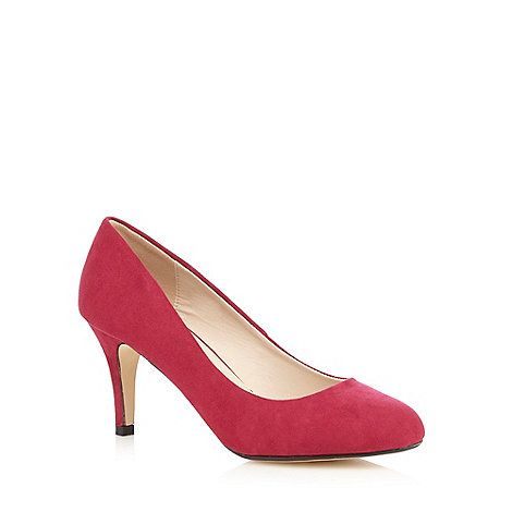 These pink court shoes from The Collection are perfect for adding a dose of colour to looks. Designed with a neat almond toe, this pair are defined with a suedette finish. The shoe will pair perfectly with a simple shift dress for a touch of classic elegance.