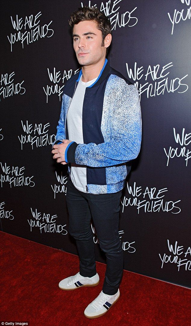 Blue boy: Zac stayed casual as well with a white T-shirt and black jeans worn with a blue-...
