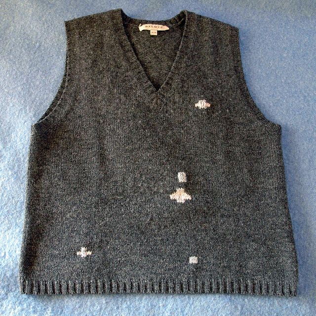 Hole-filled vest mended with Swiss darning, Becky Johnson..... What is Swiss darning? Making crosses?