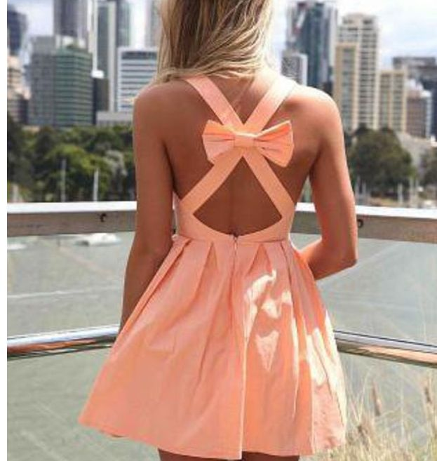 This has to be like THE cutest dress I have ever seen!!! I love the peach color and the bow, too<3