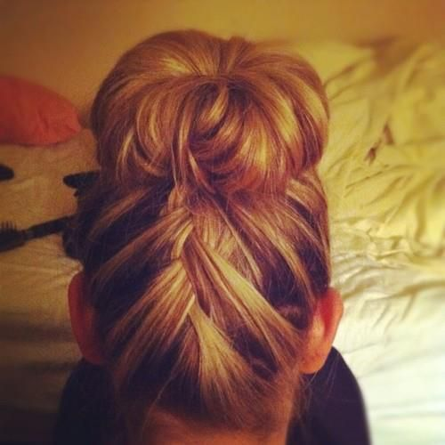 French Braided into a top bun... To do the bun use the sock method or buy a hair donut at Clair's they are soooo cheap and work for everyones hair colors and thickness!