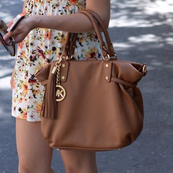Michael Kors Cross Body Bag Will be available to ship on Tuesday! Brown luggage colored leather Michael Kors handbag with cross body strap. Only used a few times. Gold accents. 100% authentic. Michael Kors Bags Crossbody Bags