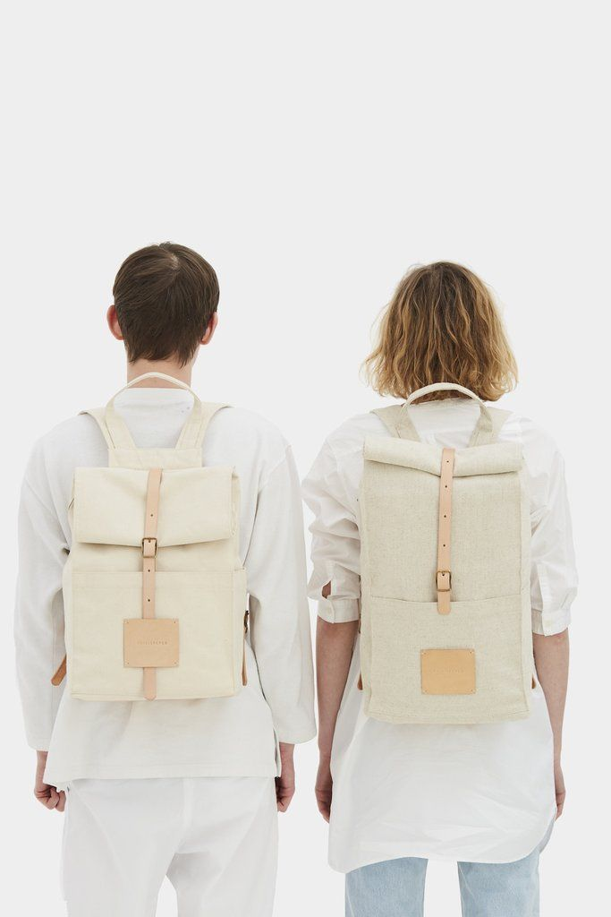 Read about Design & Production Top Roll rucksack has a front magnet pocket, interior pockets for chargers and personal organizing, interior padded cotton po