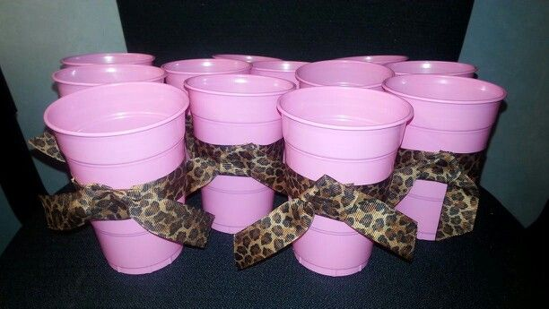 For 1st birthday party pink and leopard print. Hot clue leopard print ribbon to pink plastic cups.