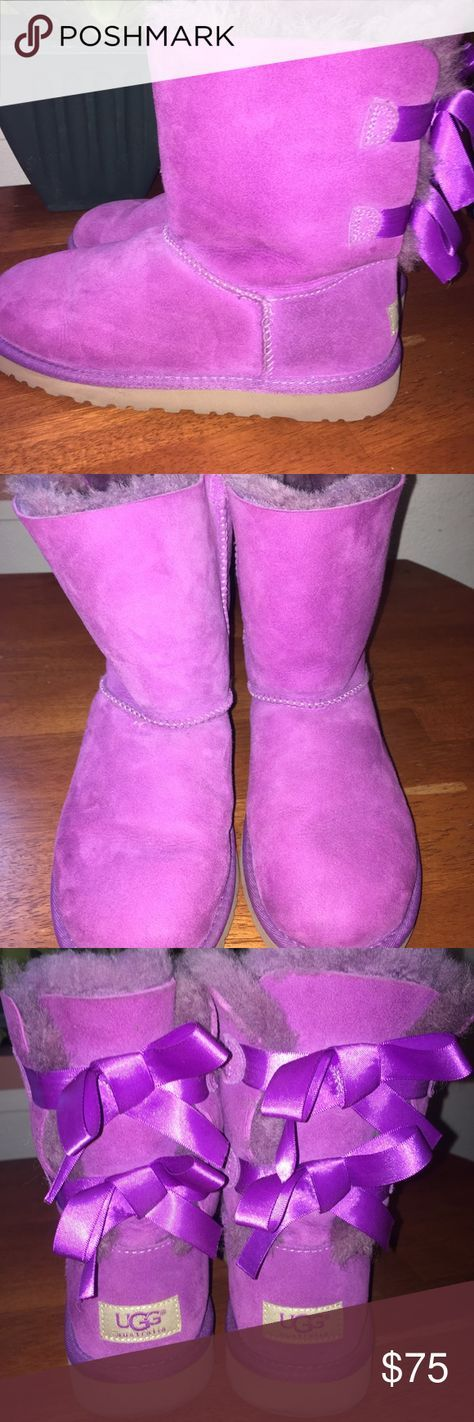 Purple Bow Uggs Kids 5/Women's 7 These boots are adult owned and in great condition. They are a kids size 5 but I wear a women's size 7 and they fit me like my women size 7 Uggs. Please refer to photos and ask questions before purchasing, thank you. The purple of these boots are bright and fun! Color is Electric violet.They don't have a smell or any visible stains, and they aren't worn down weird on the sole. UGG Shoes Winter & Rain Boots