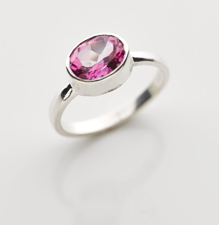 Large oval Pink Topaz set in a sterling silver band