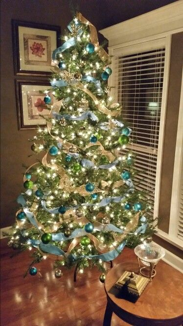 My Christmas tree done in non-traditional colors:  teal, turquoise,  green,  & gold.