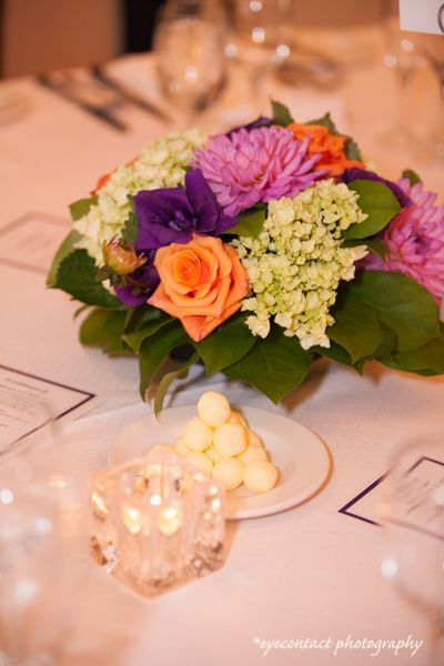 Colourful table bouquet - pink, purple, green and orange look great together! photo: www.eyecontact.ca