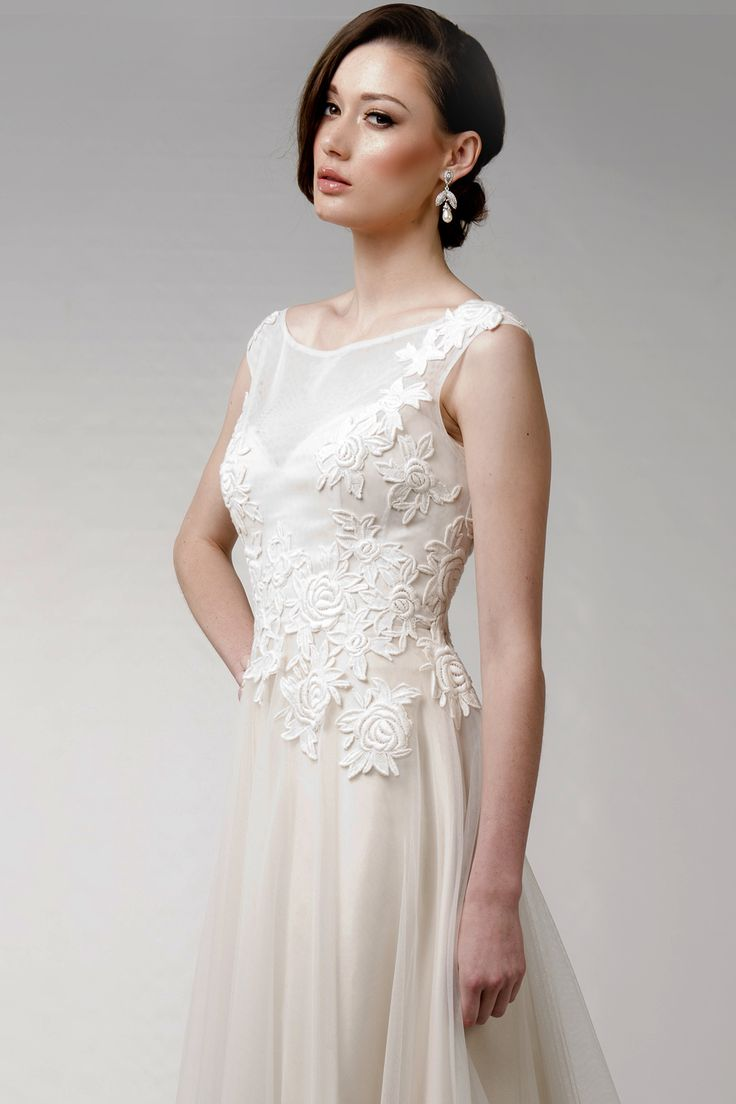 We just adore our Francis Design at Caleche Bridal. It features the most gorgeous Guipure Lace that is set-off by the Latte colour of the gown to create a vintage couture look.  Model is wearing Samantha Wills earrings