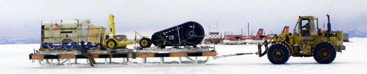 "An enormous cargo sled being maneuvered by a 10K-AT ""All Terrain"" forklift at McMurdo Station in Antarctica."