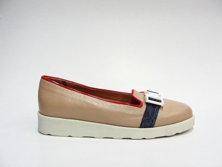 slipper.  leather upper with patented leather trimming.  rubber sole.