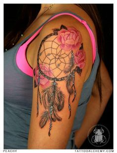 Dreamcatcher shoulder tat placement. I dig the flowers added to it.