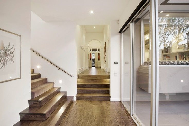 CA Architecture designed this luxury renovation and extension of a heritage home adding a large kitchen/living/dining area and a second storey.