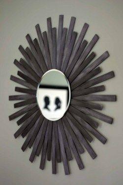 DIY sunburst mirror using paint sticks & a $3 mirror. GENIUS. love it.