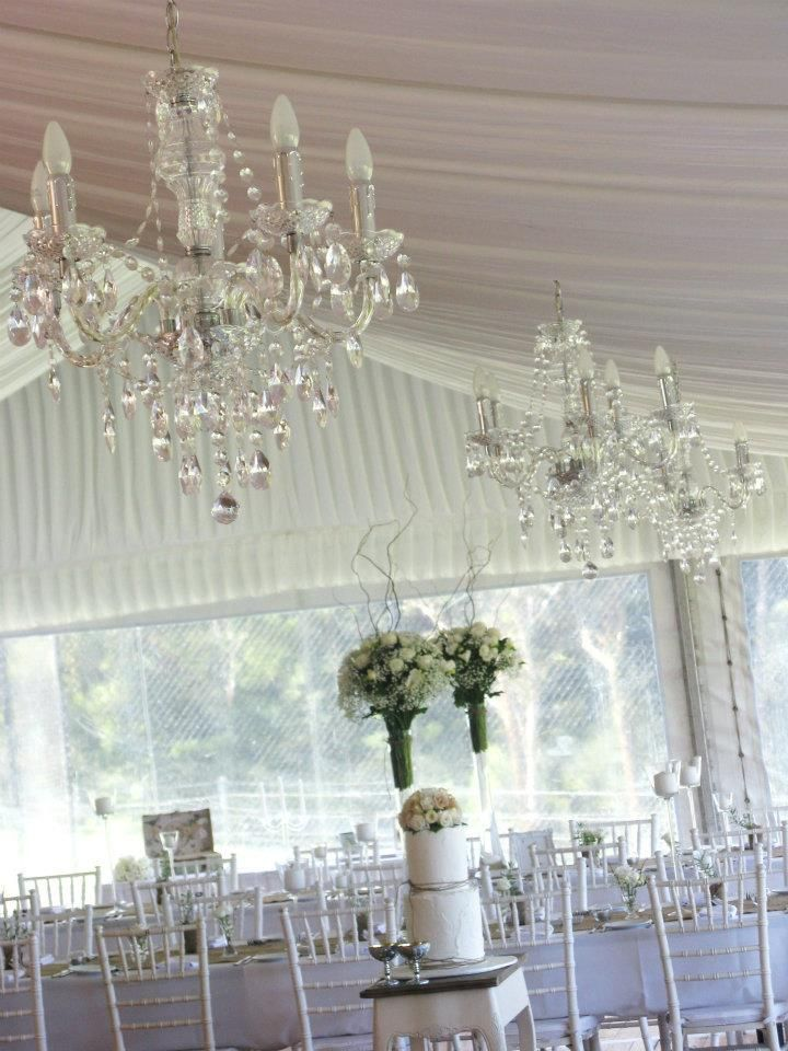 Crystal Powered Chandeliers hanging above delicious white wedding cake