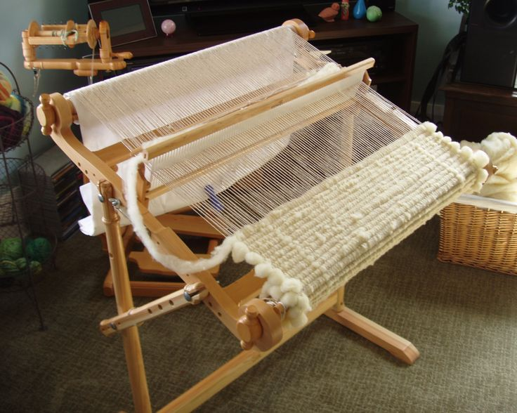 Kromski Harp set up with cotton warp and Rambouillet roving weft.