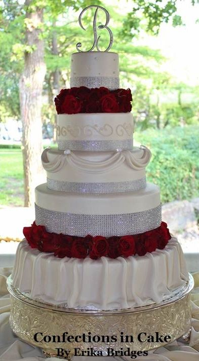 Big bling wedding cake with red roses.                                                                                                                                                                                 More