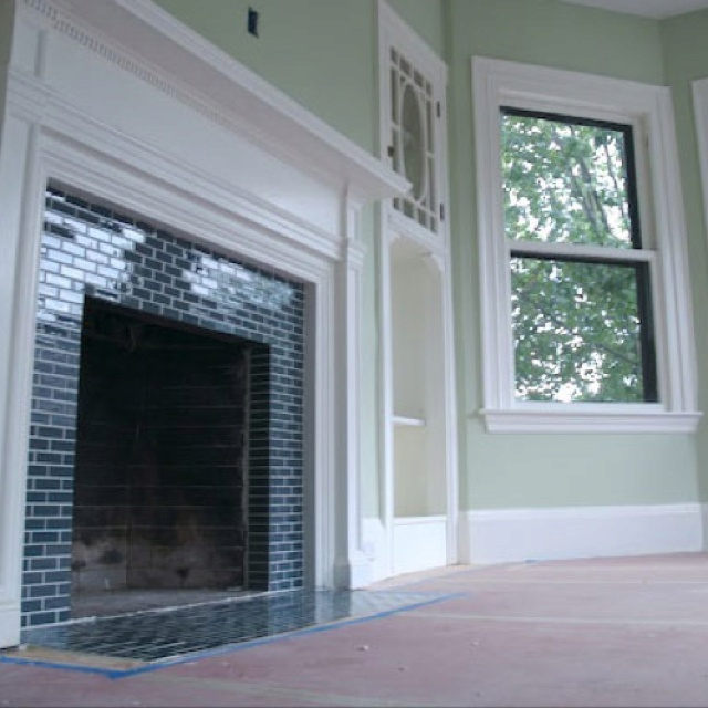 Love the tile around this fireplace! It seems like a lot of the houses we're looking at have really outdated fire places.