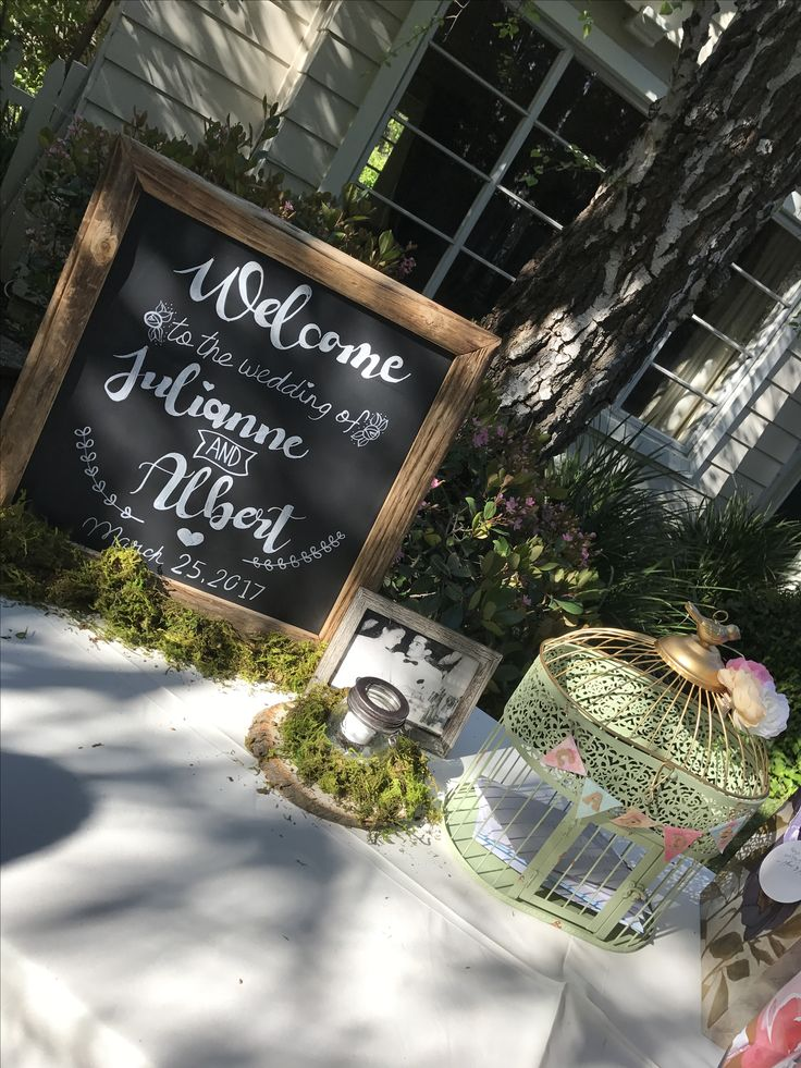 Our welcome table. The chalkboard hand lettering was done by myself using a method from Pinterest. The card cage bunting was also made from a Pinterest tutorial as well.