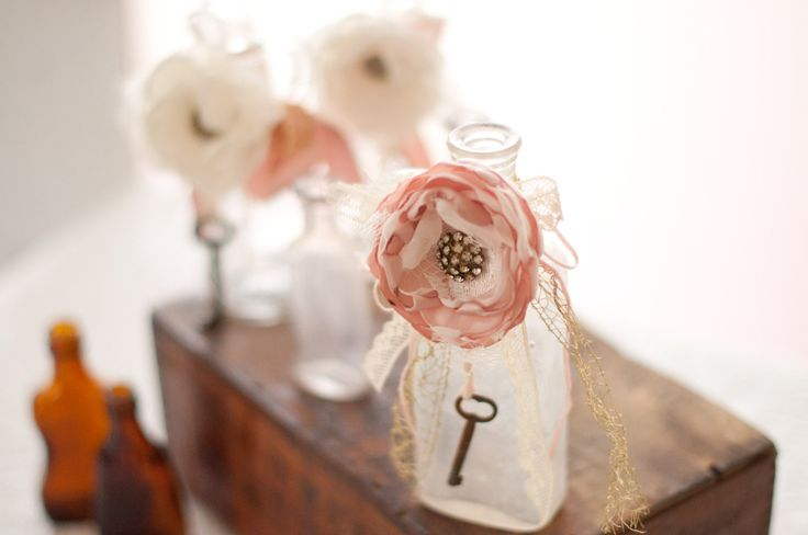 Antique glass bottle with shabby chic flower, skeleton key, wedding table decoration, ivory and blush
