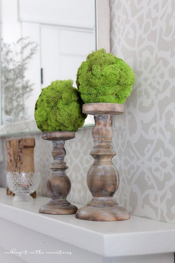 Every Farmhouse Mantel needs a few DIY Moss Topiary Balls and Shannon from AKA Designs is going to help you out with that! She shares her tutorial and it is very simple to do…you will be placing your Moss Topiary Balls on top of their Candle Sticks in no time! Oh the possibilities! ENJOY!