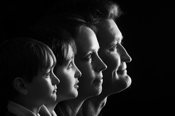Family photo ideas: how to make a striking family portrait using just a simple light source, some black fabric and some willing family members!