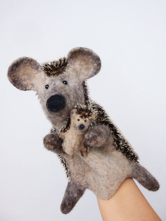 the European hedgehog hand puppet, wet felted, with a tiny baby hedgehog finger puppet