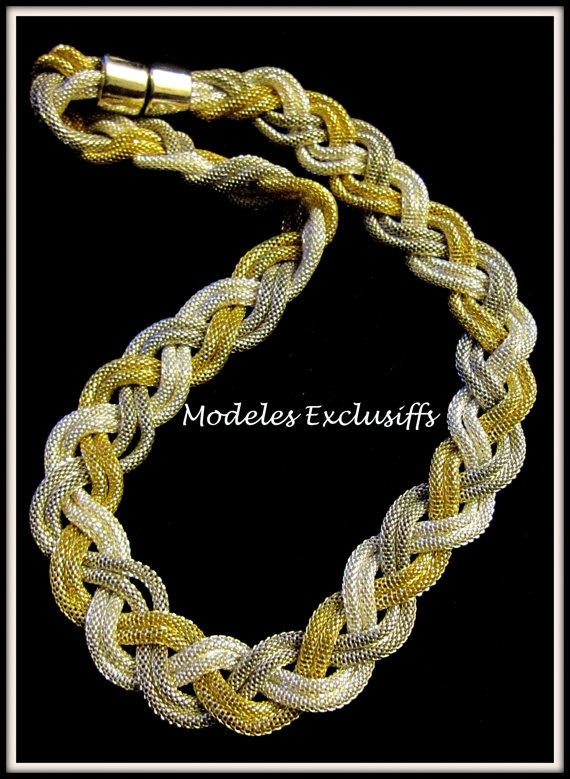 Tricolour braided necklace with dual wires of polished silver, yellow gold and black metal joined with a magnetic clasp.  A unique piece of jewellery that will make you look classic with any outfit