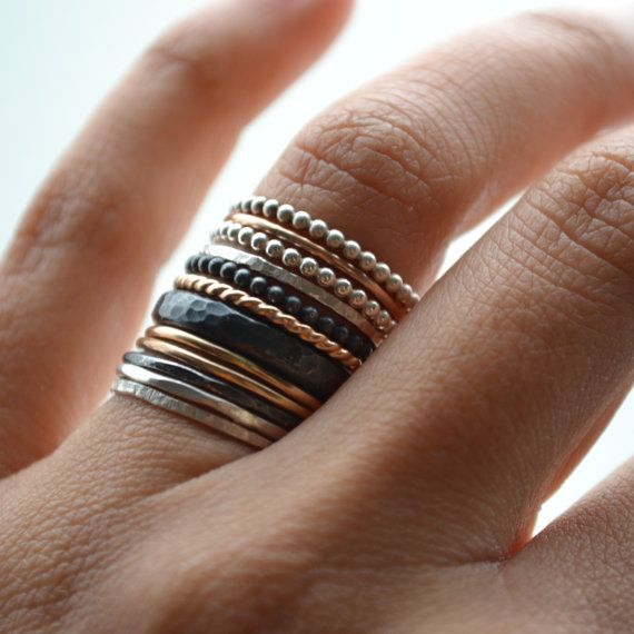 This is a big and bold stack of an eclectic mix of 14k gold filled and sterling silver rings.  Different textures and designs were put together to
