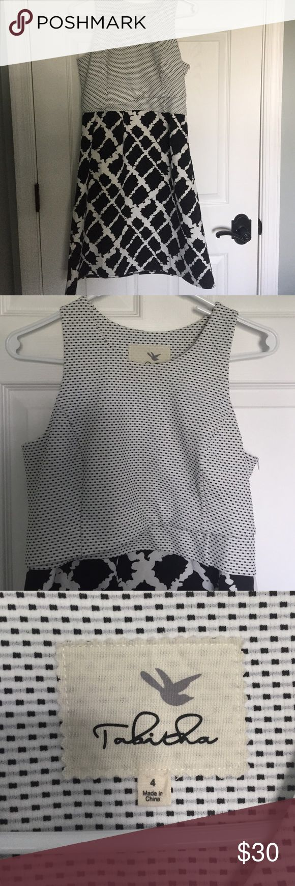 Anthropologie Black and White Dress NWOT. Purchased a size up to wear as a maternity dress and ended up delivering early. The chest area with smaller print is fitted and very flattering, but the body of the dress is A-line and very forgiving. Great dress for special occasions or work! Anthropologie Dresses