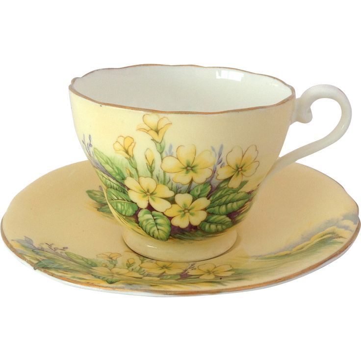 This beautifully romantic English Bone China yellow tea cup and saucer by Aynsley will give you summer Primroses all year round!   The front of the