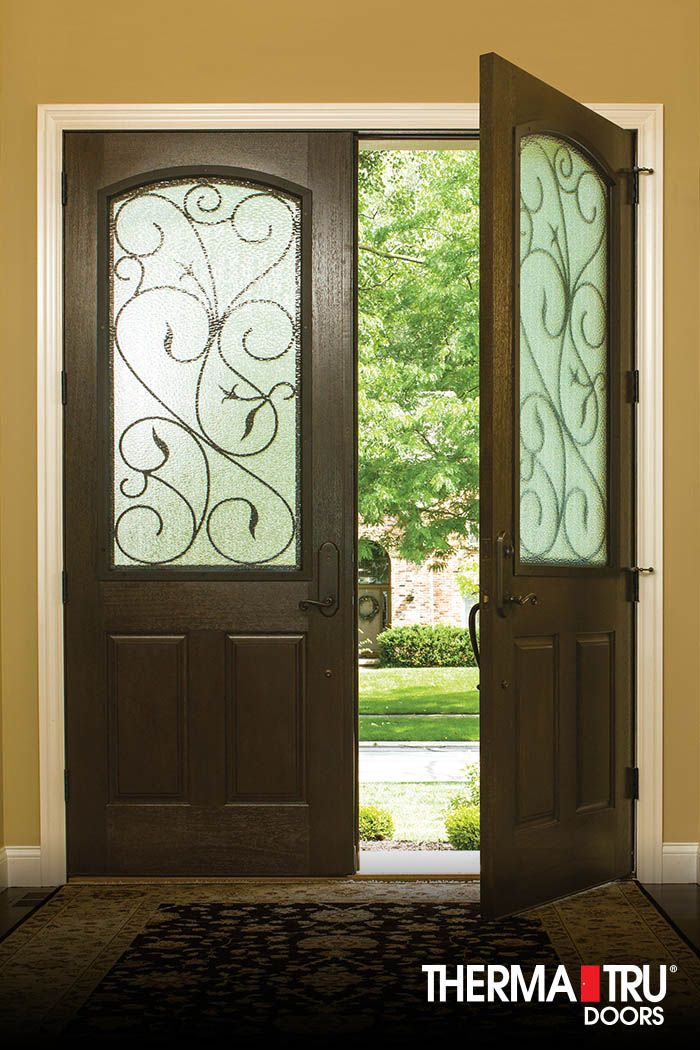 "Therma-Tru 8'0"" Classic-Craft Rustic Collection double doors with Augustine wrought iron decorative glass."