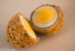 Allow eggs to cool. Bring sausage to room temperature. Roll out sausage. Wrap around egg. Wrap in plastic and refrigerate for 30 minutes. Unwrap. Beat an egg. Put egg in beaten egg until coated. Coat with bread crumbs. Spray with cooking spray. Place in 360 degree preheated airfryer for 12 minutes.