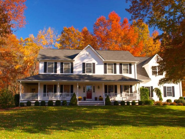 A house in the country with a wrap around porch. Curb Appeal.