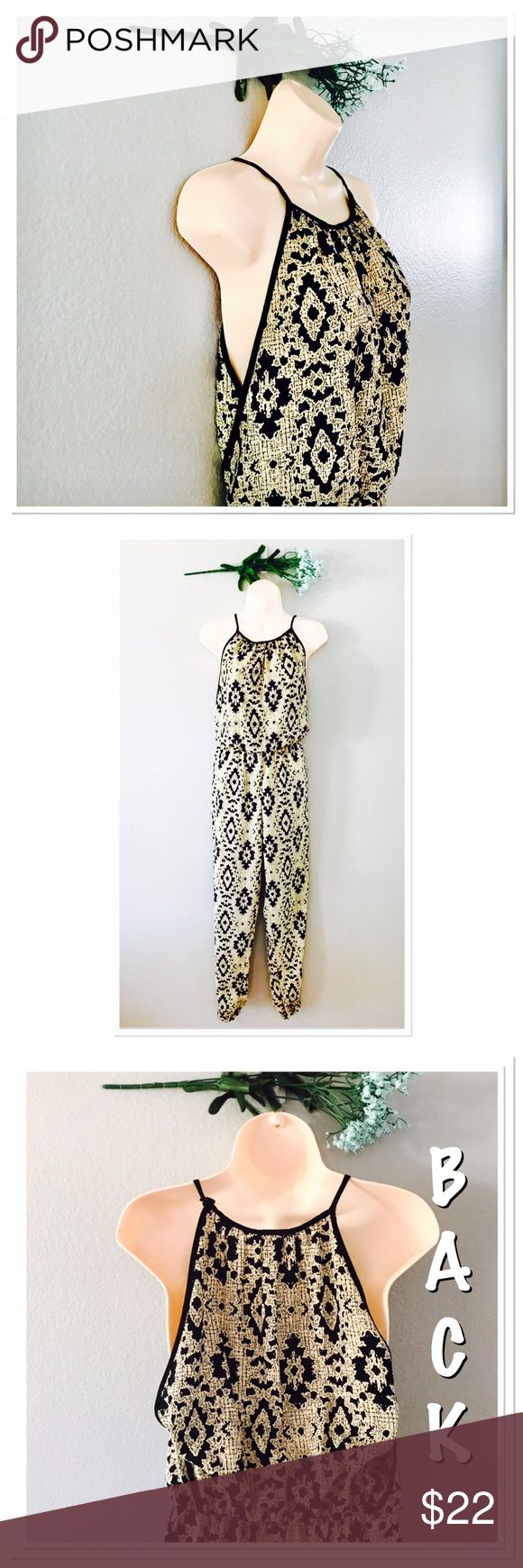 Fio Fio Aztec Jumpsuit Beautiful! In excellent condition! No flaws! Super lightweight! Cream and black. Length 55 in, inseam 26, waist 11.5 flat not stretched, waist stretched 17.5 flat, leg 10 in flat, hip 19 in flat. 100% Polyester. Elastic leg opening. Fio Fio Dresses