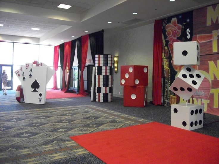 draped entry would be super easy using a couple layers of the table cover on a roll and set big dice on each side!