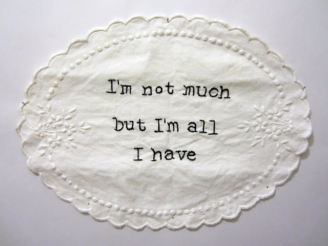 quote by Philip K. Dick embroidered onto doily from charity shop.