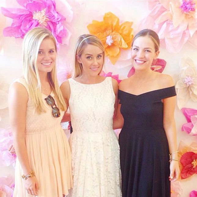 8 Ideas You Can Totally Steal from Lauren Conrad's Bridal Shower via Brit + Co.  flower wall