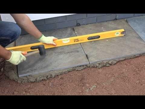 Video Laying Vitrified Patio Tiles