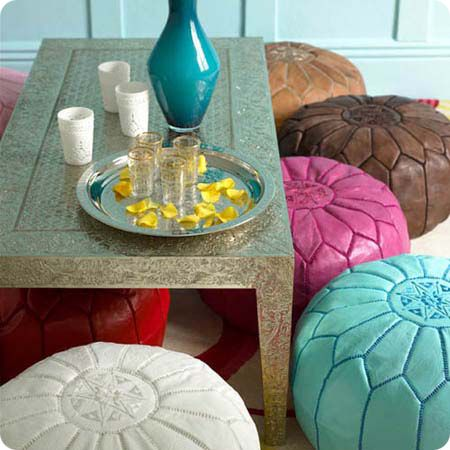 I'll take a chill tea sesh here.    A seldom-trafficked corner could be transformed into a private tea lounge by grouping a low earthy table with decorative cushions.    The poufs resemble meditation pillows, but their bright hues turn these functional seating alternatives into unexpected floor-level decor.