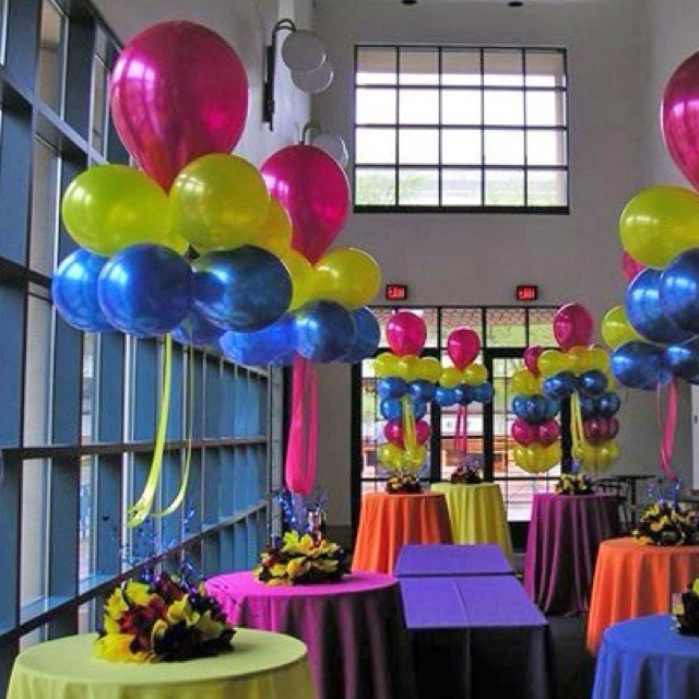 Colorful table decor - on the cheap. Balloons and plastic table clothes. Table skirts.