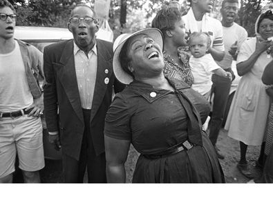 FANNIE LOU HAMER   Sharecropper and Voting Rights Activist, wearing her 'Crown'...singing during the March Against Fear, begun by James Meredith in Mississippi, 1966. She was instrumental in organizing Mississippi Freedom Summer for the Student Nonviolent Coordinating Committee (SNCC), and later became the Vice-Chair of the Mississippi Freedom Democratic Party.